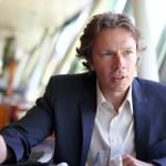 Prof. DDr. Arno SCHARL, Department Head MODUL University Vienna (www.modul.ac.at), innen, sitzend, Interview